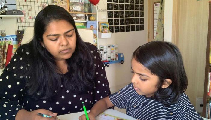 Gracelyne Fernando teaching her son