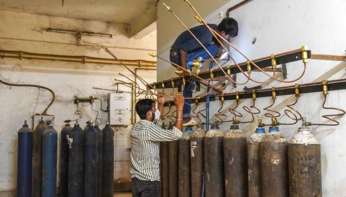 Workers at an oxygen filling station at Gauhati Medical College and Hospital