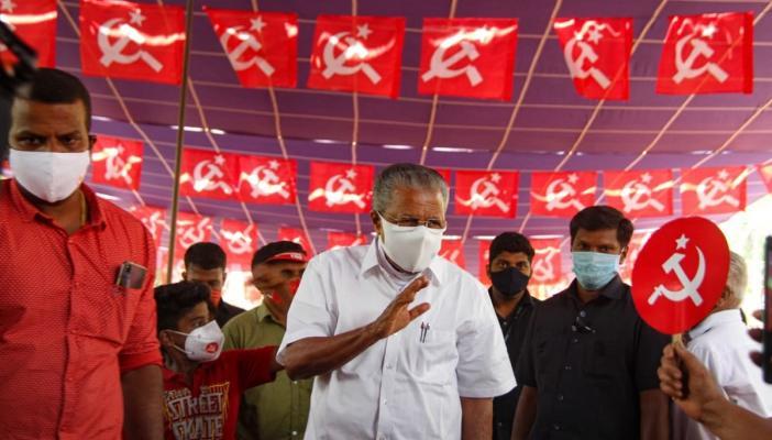 Kerala CM Pinarayi waving at supporters
