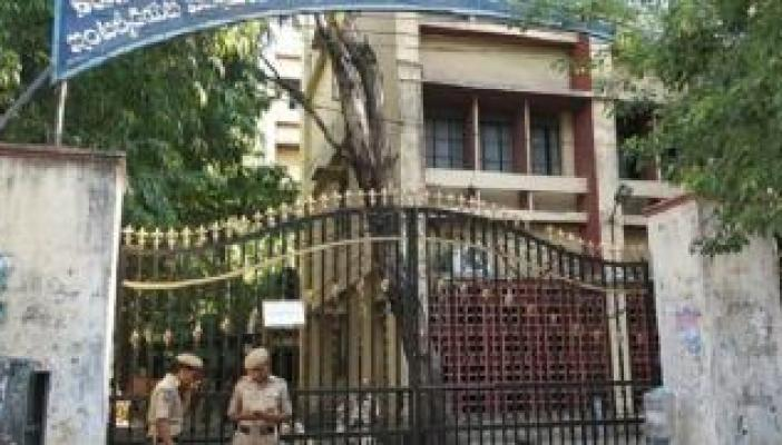 Telangana intermediate Board office with police personnel standing outside the gate